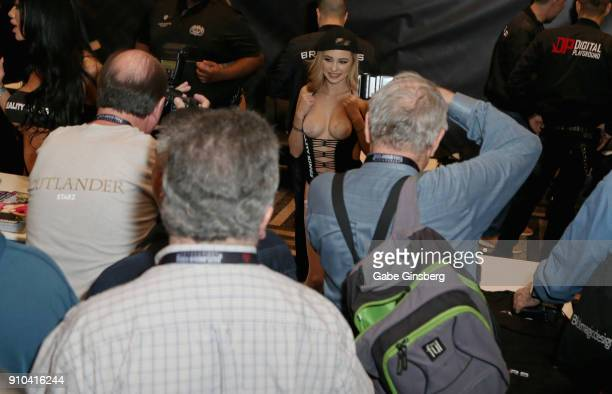 Fans take photos of adult film actress Carolina Sweets at the Brazzers booth during the 2018 AVN Adult Expo at the Hard Rock Hotel Casino on January...