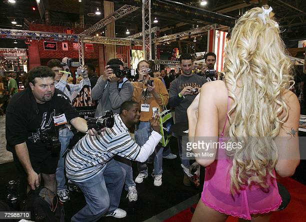 Fans take photos of adult film actress Jenna Cumz at the Adult Video News Adult Entertainment Expo at the Sands Expo Center January 12 2007 in Las...