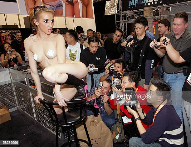 Fans take photos of adult film actress Tiffany Holiday at the Anabolic/Diabolic booth at the Adult Video News Adult Entertainment Expo at the Sands...