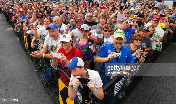 Fans take photos of Dale Earnhardt Jr driver of the Mountain Dew Chevrolet during the Monster Energy NASCAR Cup Series Alabama 500 at Talladega...