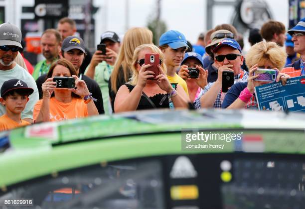 Fans take photos of Dale Earnhardt Jr's Mountain Dew Chevrolet during the Monster Energy NASCAR Cup Series Alabama 500 at Talladega Superspeedway on...