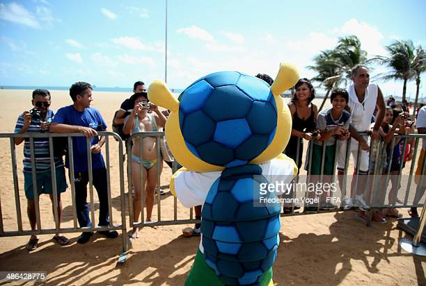 Fans take photos of the FIFA mascot at the FIFA Fan Fest during the 2014 FIFA World Cup Host City Tour on April 24 2014 in Fortaleza Brazil