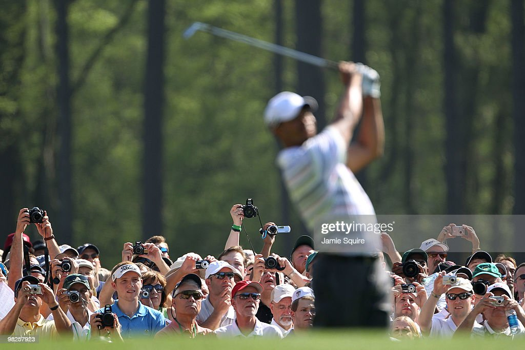 Fans take photos of Tiger Woods as he hits a shot during a practice round prior to the 2010 Masters Tournament at Augusta National Golf Club on April 5, 2010 in Augusta, Georgia.