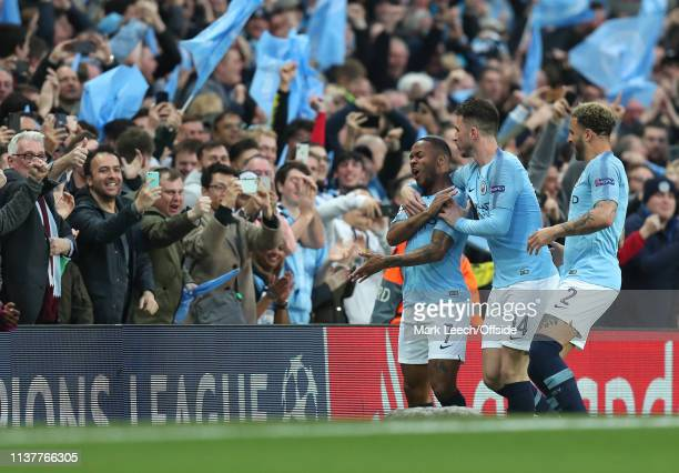Fans take photos on their phones as Raheem Sterling of Man City celebrates scoring their 3rd goal during the UEFA Champions League Quarter Final...