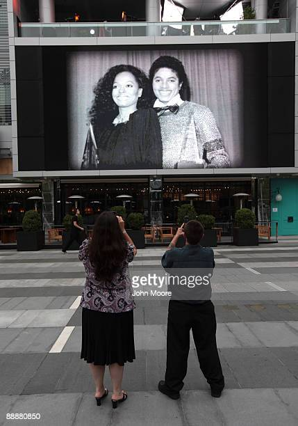 Fans take photos outside the Michael Jackson public memorial service held at Staples Center on July 7, 2009 in Los Angeles, California. Jackson the...