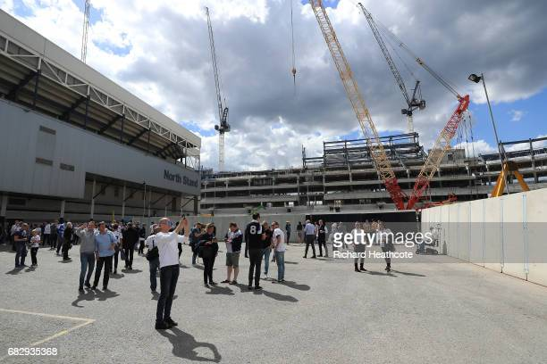 Fans take photos outside the new stadium site prior to the Premier League match between Tottenham Hotspur and Manchester United at White Hart Lane on...