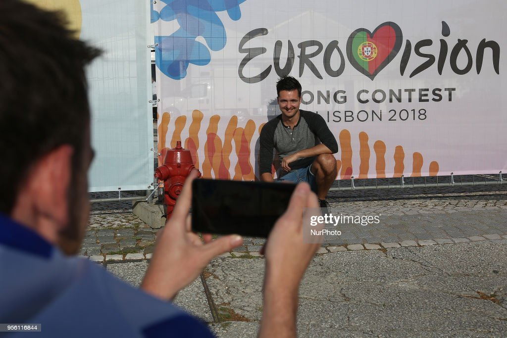 Fans take pictures in front of the Eurovion logo before the first semi-final of the 2018 Eurovision Song Contest, at the Altice Arena in Lisbon, Portugal on May 8, 2018.