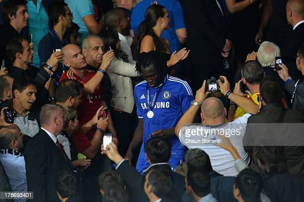 Fans take pictures of Romelu Lukaku of Chelsea after he collected his runners up medal during the UEFA Super Cup between Bayern Muenchen and Chelsea...