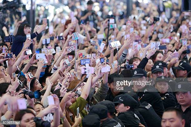 Fans take pictures of South Korean rapper GDragon at Hyundai booth during 2016 Beijing International Automotive Exhibition on April 25 2016 in...