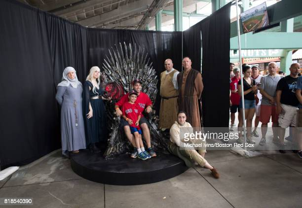Fans take pictures with the Iron Throne during Game of Thrones night at Fenway Park on July 18 2017 in Boston Massachusetts