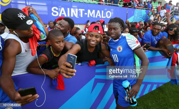 Fans take selfies with Nerille Mondesir of Haiti during the FIFA U20 Women's World Cup France 2018 group D match between Haiti and China PR at on...