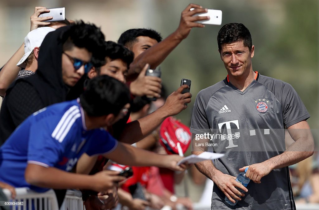 Fans take selfies with Robert Lewndowski after a training session at day 2 of the Bayern Muenchen training camp at Aspire Academy on January 4, 2017 in Doha, Qatar.