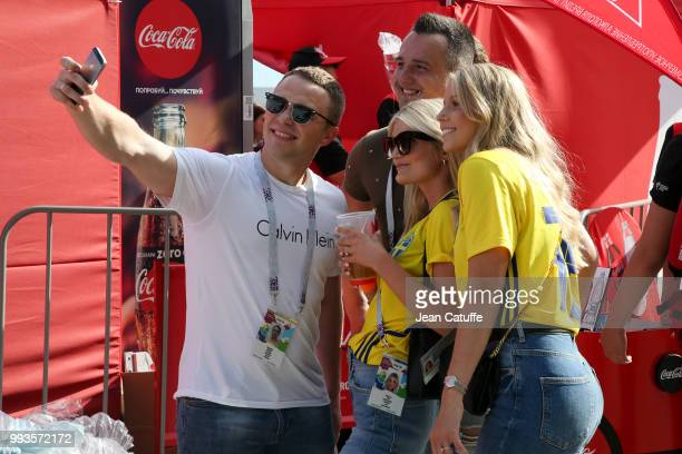 Fans take selfies with wives and girlfriends of Swedish players before the 2018 FIFA World Cup Russia Quarter Final match between Sweden and England...