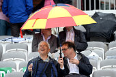 london england fans take shelter from
