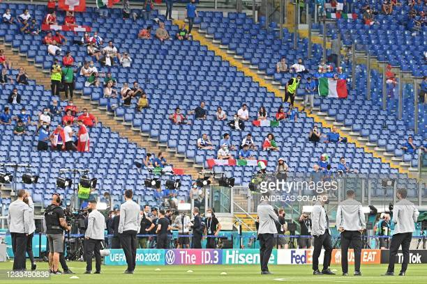 Fans take their seats ahead of the UEFA EURO 2020 Group A football match between Italy and Switzerland at the Olympic Stadium in Rome on June 16,...