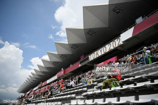 Fans take their seats in the stands prior to the start of the women's cycling road individual time trial during the Tokyo 2020 Olympic Games at the...