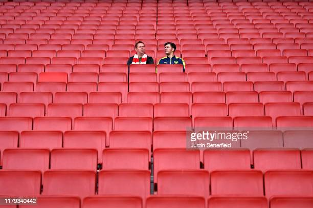 Fans take their seats prior to the Premier League match between Arsenal FC and AFC Bournemouth at Emirates Stadium on October 06, 2019 in London,...