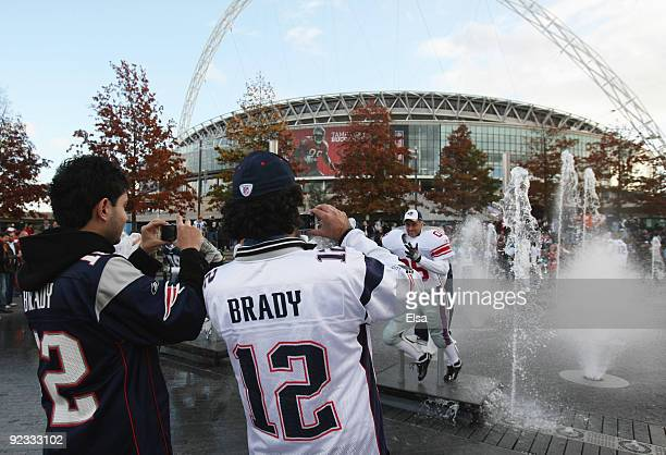 Fans takes photographs prior to the NFL International Series match between New England Patriots and Tampa Bay Buccaneers at Wembley Stadium on...