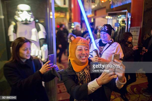 Fans takes sefies near a storm trooper display at a screening on opening night of Walt Disney Pictures And Lucasfilm's Star Wars The Force Awakens at...