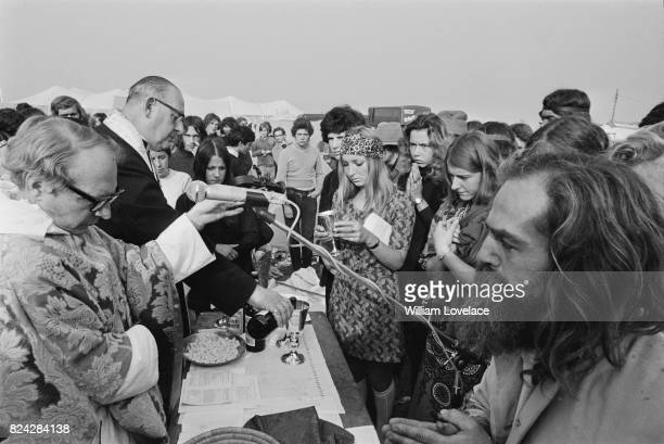 Fans taking Communion at the 1970 Isle of Wight Festival 31st August 1970 The festival was held between 26 and 31 August 1970 at Afton Down UK