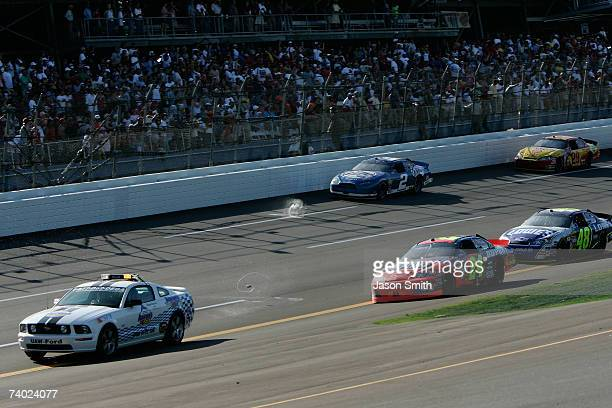 Fans throw beer cans onto the track as Jeff Gordon driver of the Dupont Chevrolet after Gordon won the NASCAR Nextel Cup Series Aaron's 499 under...