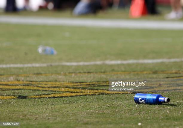 Fans throw bottles onto the field during a match between the Washington Redskins and the Philadelphia Eagles on September 10 at FedExField in...