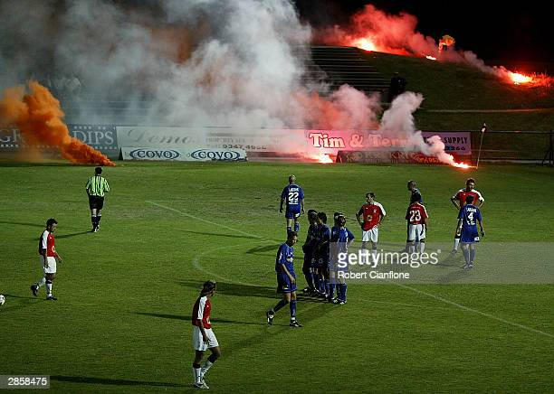 Fans throw flares onto the ground during the round 19 NSL match between the South Melbourne and Sydney United at the Bob Jane Stadium Stadium on...