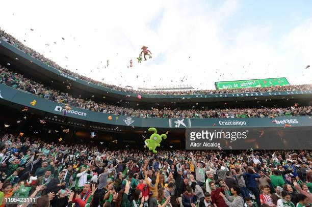 Fans throw toys onto the pitch for charity at half time of the Liga match between Real Betis Balompie and Club Atletico de Madrid at Estadio Benito...