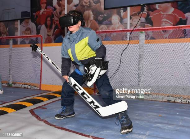 Fans try out a virtual reality goalie challenge in The PreGame in advance of the 2019 Tim Hortons NHL Heritage Classic as the Calgary Flames take on...