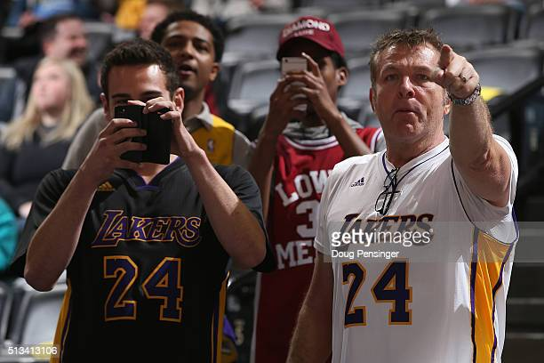 Fans try to capture a photo of Kobe Bryant of the Los Angeles Lakers as he warms up prior to facing the Denver Nuggets at Pepsi Center on March 2...