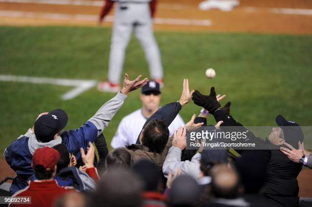 Fans try to catch a foul ball during Game Six of the 2009 MLB World Series between the Philadelphia Phillies and the New York Yankees at Yankee...