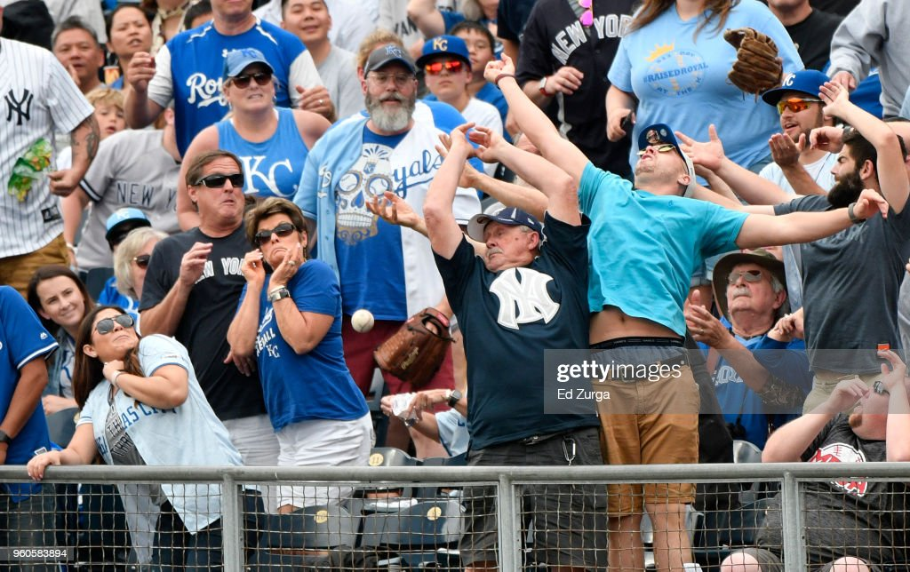 Fans try to catch a foul ball hit by Miguel Andujar #41 of the New York Yankees in the fifth inning during a game against the Kansas City Royals at Kauffman Stadium on May 20, 2018 in Kansas City, Missouri.