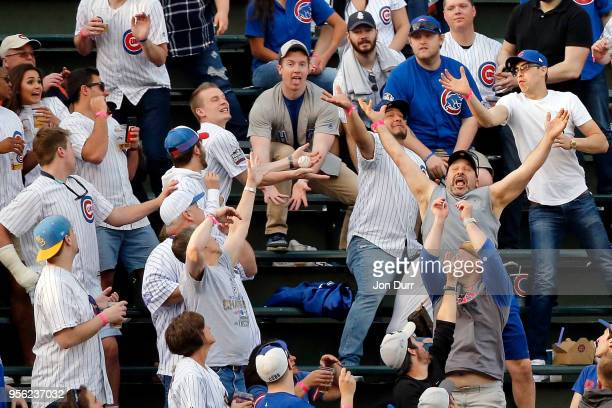 Fans try to catch the two run home run ball hit by Justin Bour of the Miami Marlins against the Chicago Cubs during the first inning at Wrigley Field...