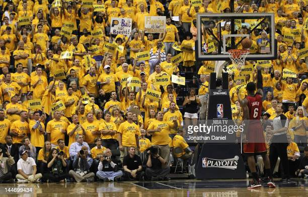 Fans try to distrack LeBron James of the Miami Heat as he shoots a free throw against the Indiana Pacers in Game Three of the Eastern Conference...