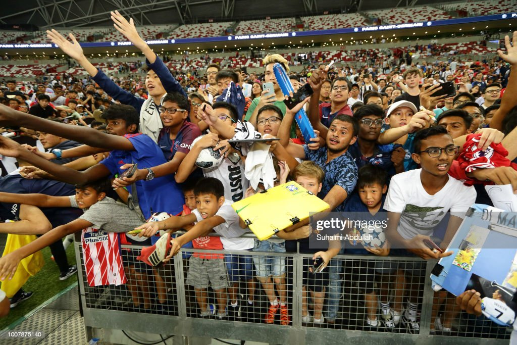 Fans try to get autographs during the International Champions Cup 2018 match between Atletico Madrid and Paris Saint Germain at the National Stadium on July 30, 2018 in Singapore.