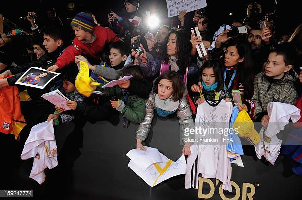 Fans try to get autographs from attending guests on the red carpet during the FIFA Ballon d'Or Gala 2012 at the Kongresshaus on January 7 2013 in...