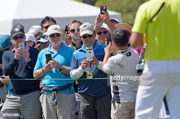 Fans try to get pictures of Rickie Fowler at hole No 9 during the second round of the Arnold Palmer Invitational presented by MasterCard at Bay Hill...