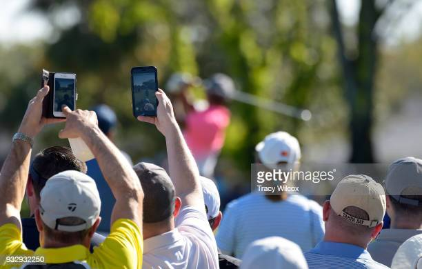 Fans try to get pictures of Tiger Woods during the second round of the Arnold Palmer Invitational presented by MasterCard at Bay Hill Club and Lodge...