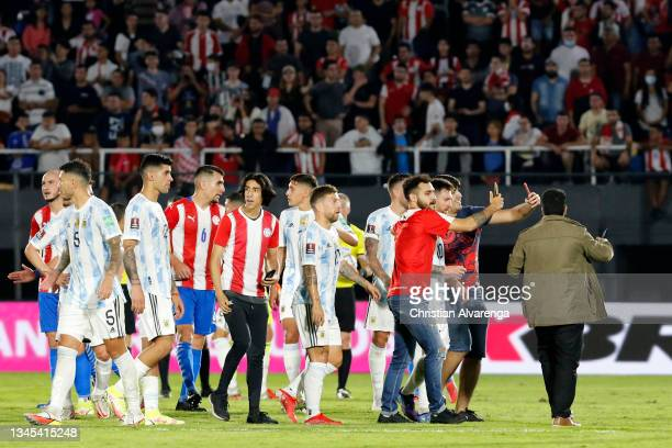 Fans try to get pictures with Lionel Messi of Argentina after a match between Paraguay and Argentina as part of South American Qualifiers for Qatar...
