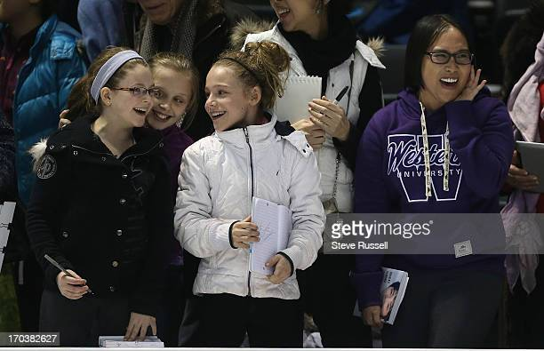 Fans try to get the attention of Japan's Yuzuru Hanyu after he practices in preparation for the ISU World Figure Skating Championships at Budweiser...