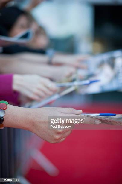 fans trying to get autographs - groupie stock pictures, royalty-free photos & images