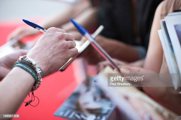 fans trying to get autographs - autographs stock photos and pictures