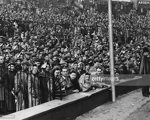Fans trying to shelter from the rain at Wembley Stadium during the FA Cup final betwen Arsenal and Liverpool 29th April 1950 Arsenal won the match 20