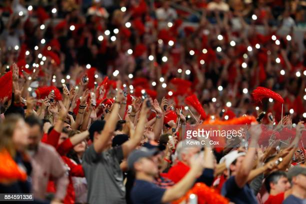 Fans turn on their phone flashlights to signal the start of the fourth quarter during the SEC Championship between the Georgia Bulldogs and the...