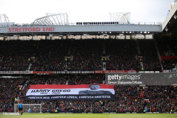 Fans unfurl a giant banner in the Stretford End to remember former player Harry Gregg before the Premier League match between Manchester United and...