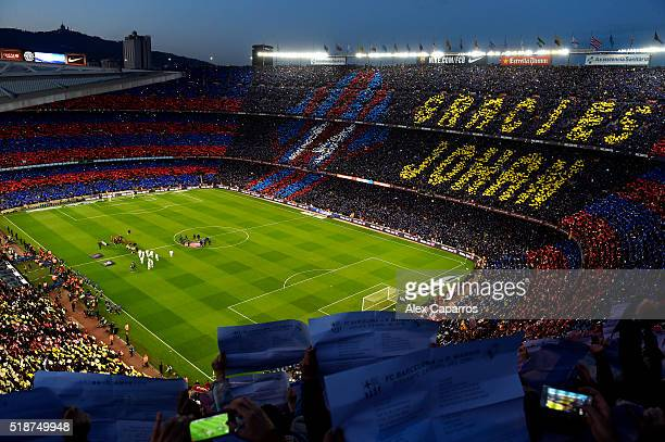 Fans unveil a mosaic tribute to the former FC Barcelona player and manager, Johan Cruyff as the players shake hands before the La Liga match between...