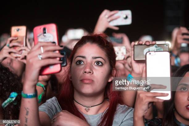Fans use their cell phones at the start of Imagine Dragons concert during the first day of Lollapalooza Buenos Aires 2018 at Hipodromo de San Isidro...