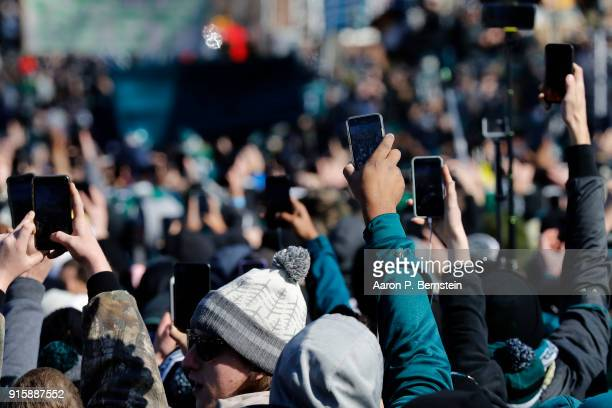 Fans use their cell phones to record the arrival of the Philadelphia Eagles Super Bowl parade on February 8, 2018 in Philadelphia, Pennsylvania.