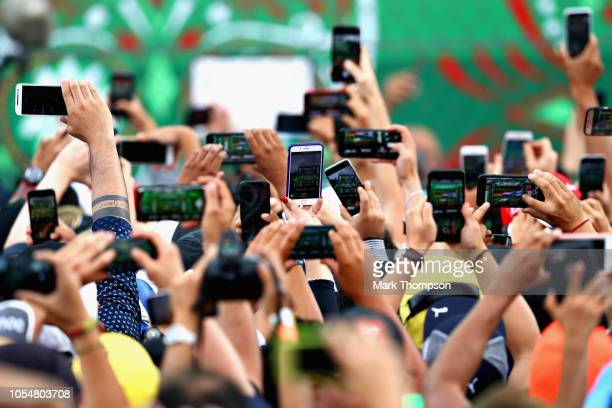 Fans use their smart phones to record footage of the podium after the Formula One Grand Prix of Mexico at Autodromo Hermanos Rodriguez on October 28,...