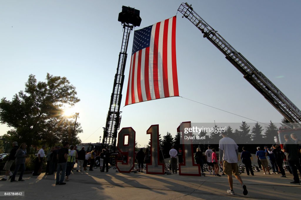 Fans view a display in remembrance of the events of September 11, 2001 before the game between the Milwaukee Brewers and the Pittsburgh Pirates at Miller Park on September 11, 2017 in Milwaukee, Wisconsin.